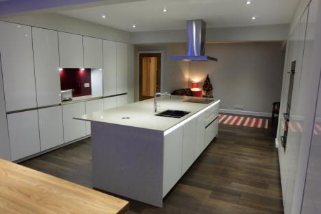 high gloss handleless kitchen with centre island