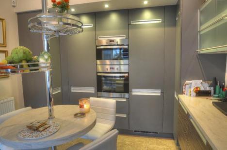 Clam Shell corian replaces a dark Iroko design kitchen
