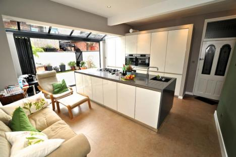 Fitted kitchen with bi-fold doors and island.