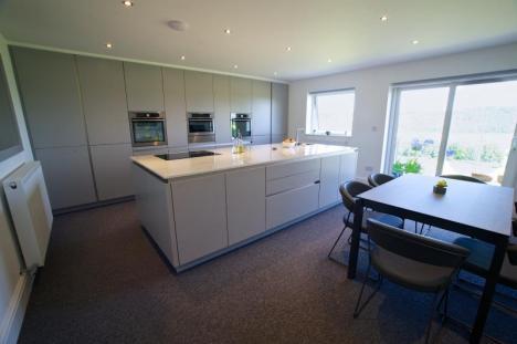 Keller handleless kitchen with AEG appliances