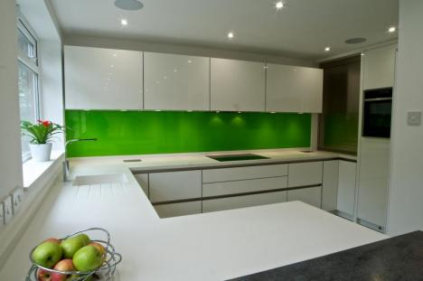 Keller GL4100 handless kitchen with Corian Cameo white tops