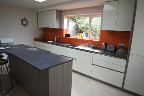 Keller high gloss handleless fitted kitchen with Formica laminated tops
