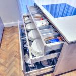 Open drawers showing storage under hob