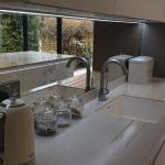 sink area of the worktop with seamlessly moulded bowl and integrated drainer grooves