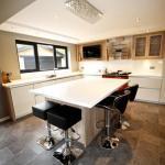 Keller kitchen with island, breakfast bar and Karndean flooring