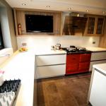 Aga oven in a Keller gloss kitchen with Karndean flooring