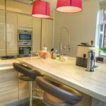 High gloss lacquer meets corian surfaces.