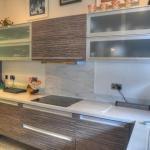 bi-fold glass wall units with illuminated glass bottoms