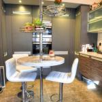 Clam shell corian breakfast bar replaces dark Iroko design kitchen laminate top