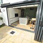New fitted kitchen in Lytham with bi-fold doors and centre island