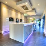 gloss white and rough oak fitted kitchen with large centre island
