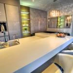 Gloss white kitchen with island and breakfast bar