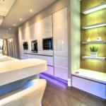 Gloss white tall units with Miele appliances
