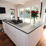 centre island with hob. bifold doors.