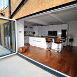 contemprary fitted kitchen with island and bifold doors