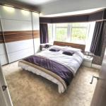 Matching the bed and bedside tables to the sliding wardrobe doors