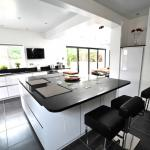 fitted kitchen with large island and breakfast bar