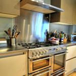 stainless steel worktops compliment the range cooker and extractor