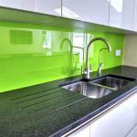 green glass splashback with LED lighting