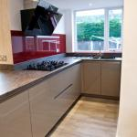 handleless gloss kitchen featuring a Neff perimeter extractor