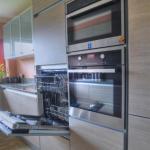 Fitted Kitchen features a Kuppersbusch waist high dishwasher.