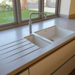 Corian worktops with moulded sinks.