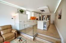 Keller fitted kitchen featuring Corian Neff and Amtico products