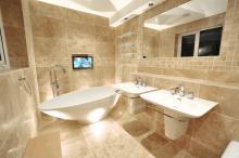new fitted bathroom with teardrop bath