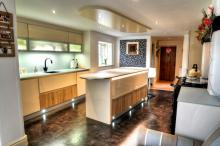 Handleless fitted kitchen-fridge drawers in island unit Lechner glass worktops no more Iroko