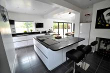 new fitted kitchen with large centre island handleless style