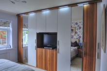 Fitted bedroom finished in walnut veneer & silk lacquer.
