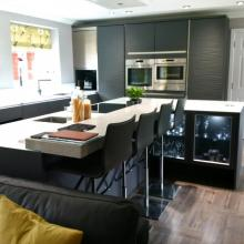 Keller fitted kitchen featuring glass and quartz stone worktops