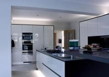 High gloss kitchen features Kuppersbusch appliances, Silestone worktops and an Air Uno Extractor