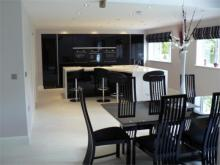 gloss black kitchen doors and Corian Venaro tops